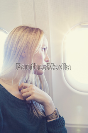 blond young woman in airplane