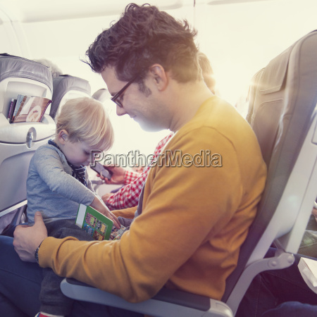 father with son in airplane