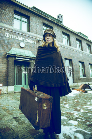 germany berlin woman carrying suitcase in