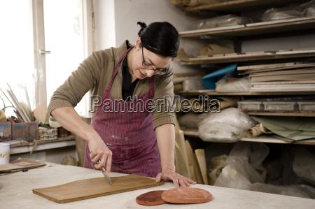 germany bavaria mid adult woman cutting