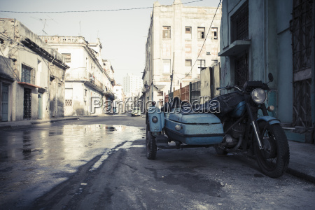 cuba parking old motorcycle combination on
