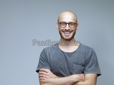 portrait of smiling man with crossed