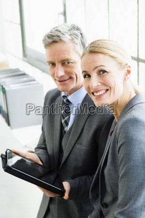 germany businesspeople working on digital tablet