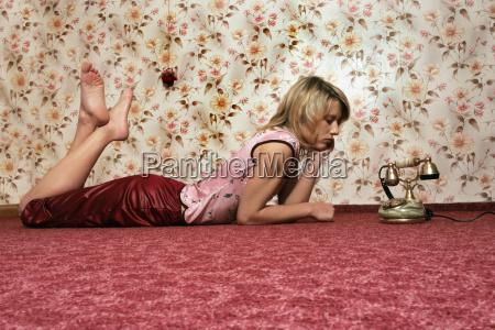 young woman lying on floor looking