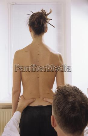 massage woman standing rear view