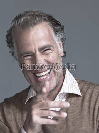 man laughing pointing portrait