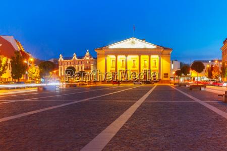 town hall square at night vilnius