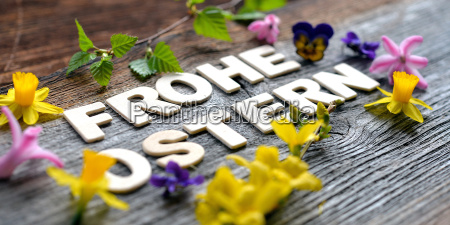 happy easter on wooden background