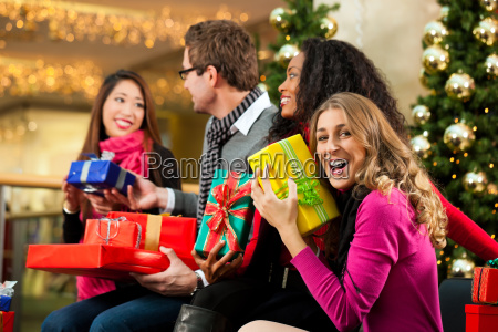 christmas shopping friends in mall