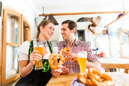 couple drinking wheat beer in bavarian