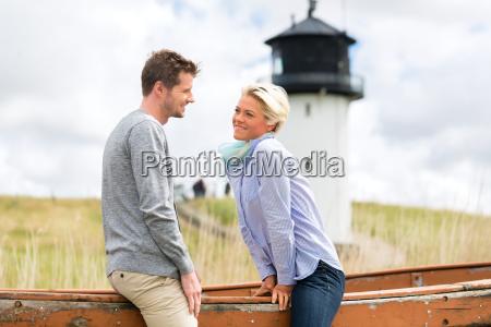 couple enjoying holiday in beach dune