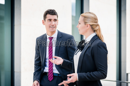 business man and woman discussing