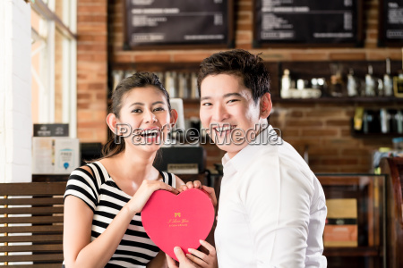 asian couple having date in coffee