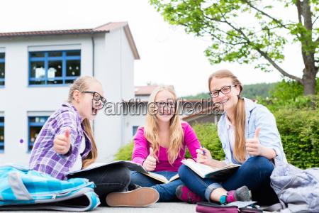 students doing homework for school together