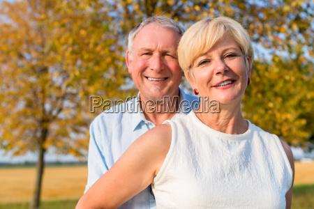 senior woman and man couple embracing