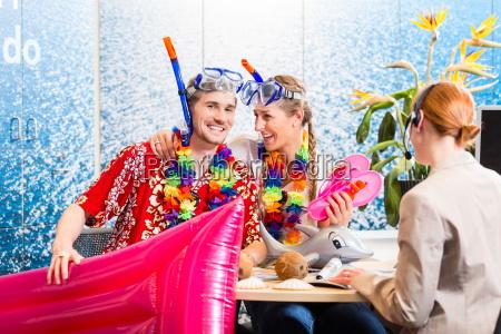 man and woman booking beach holiday