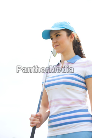 confident woman looking away while holding