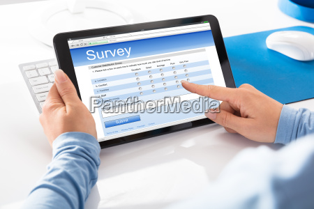 woman holding digital tablet with an