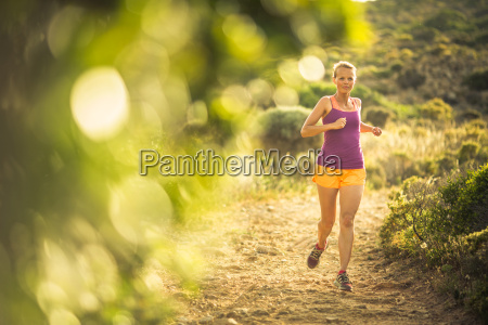 young woman running outdoors on a