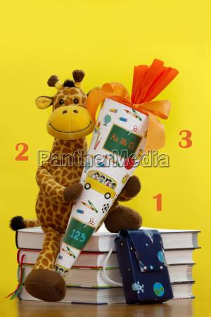 jirafa mochila libro