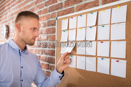 businessman looking at notes