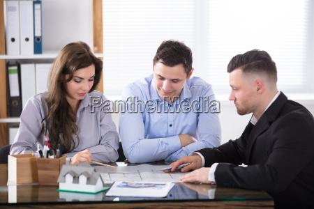 real estate agent meeting with couple