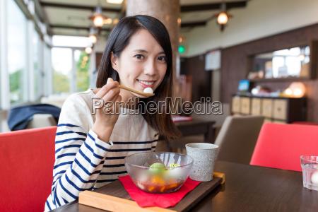 woman enjoy japanese dessert in cafe