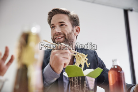 businessman having lunch break with asian