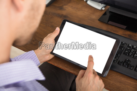 businessman using digital tablet at workplace