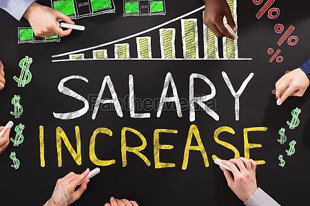 aumento salarial dibujo en blackboard
