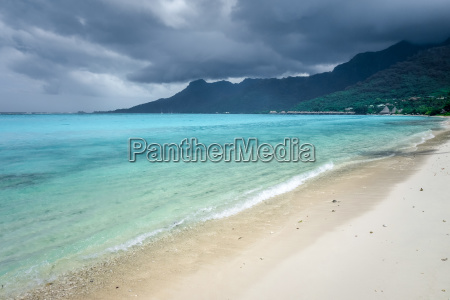 cloudy sky on temae beach lagoon