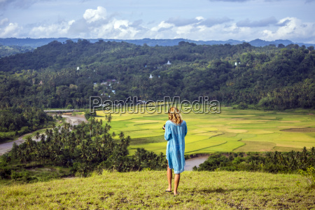 woman at mountains sumba indonesia