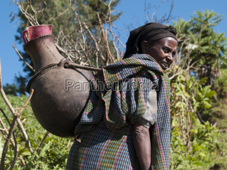 a woman carrying a large traditional