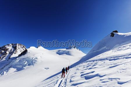 ski tourers on monte rosa border