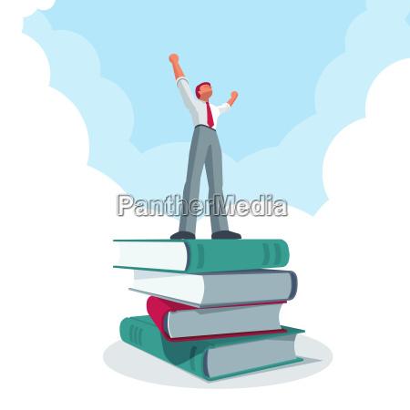 successful businessman standing on big book