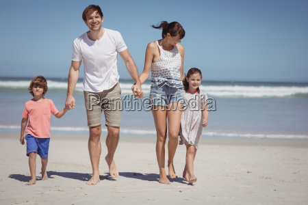 happy man walking with his family