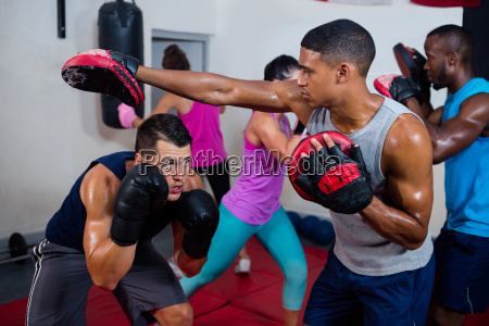 boxer defending with male instructor