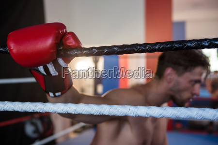 side view of tired male boxer