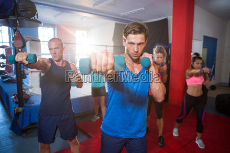 young athletes punching with dumbbells