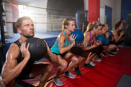 group of young athletes exercising with