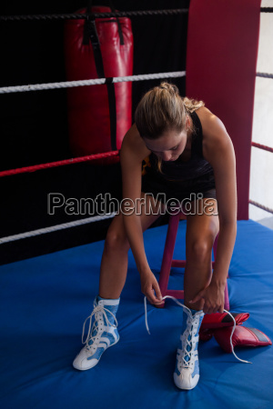 woman wearing shoes in boxing ring