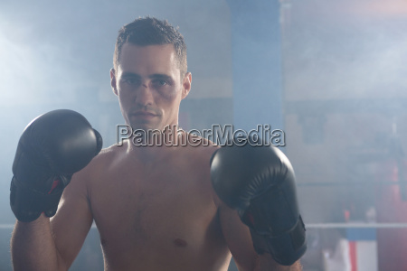 portrait of young male boxer with