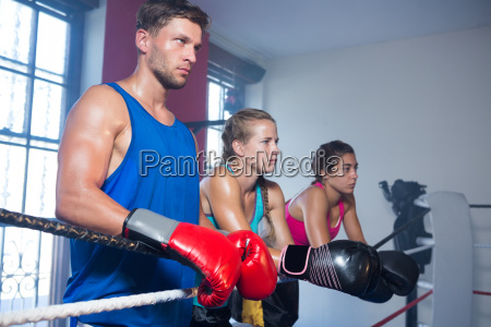 young male boxer standing by female