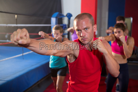 portrait of young athlete punching by