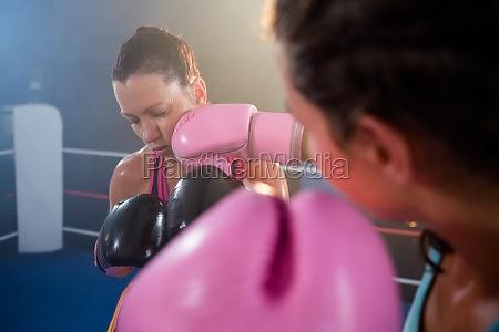 close up of female boxer punching