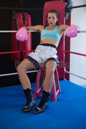 portrait of tired female boxer sitting
