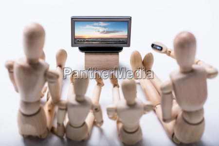 wooden, dummy, family, watching, video - 23584108