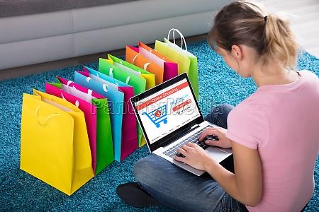 woman shopping online using laptop
