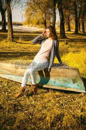 slim girl in blue jeans brown