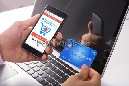 person holding credit card in hand